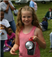 Young girl smiling with a large flashlight
