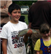 Young boy holding a fish