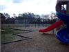 Playground corkscrew slide and red slide