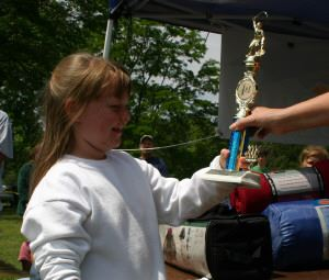 Young girl receiving a trophy