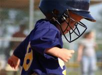 Child wearing a baseball helmet