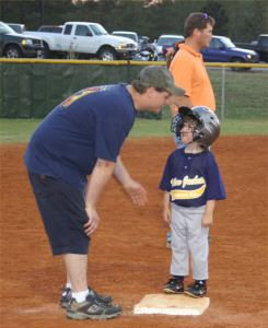 Coach talking to a small child