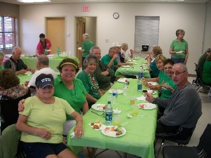 People wearing all green using the Community Room